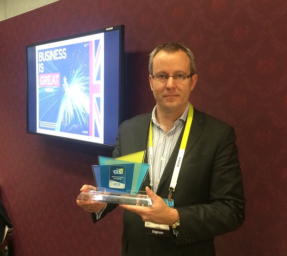Julian Hughes picks up the 2015 CES Innovation Award.